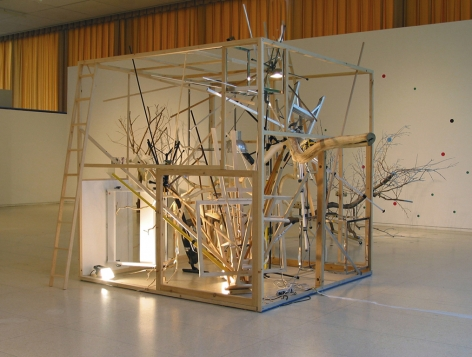 MICHAELA. ROBINSON | OEUVRE RIRE LA FEU NAÎTRE (TREE HOUSE) | BRANCHES, ELECTRONIC SINGING BIRDS, LAMPS, MAQUETTE, DRAWING TABLE | 78 X 78 INCHES | 2006,