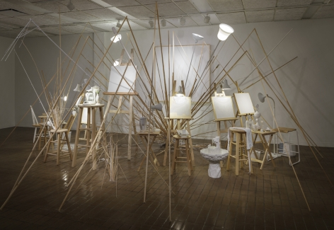 MICHAELA. ROBINSON | TROU BLANC (WHITE HOLE) | WOOD, WHITE PAINTINGS, VARIOUS WHITE OBJECTS, ART SUPPLIES, BRANCHES, LAMPS, ETC. | VARIABLE DIMENSIONS | 2012