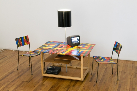 Franz West Creativity: Furniture Reversal, 1998 Two chairs, table, lamp, colored duct tape and video (which colapses into its own crate) 28 1/2 x 38 x 28 in. / 72.4 x 96.5 72.1 cm. (closed dimensions) Edition of 30