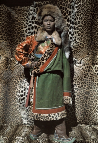 Joseph F Rock- A Nashi Man Stands in Front of Robes Made from Leopard Skin