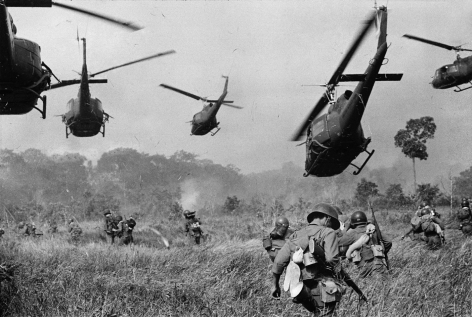 Horst Faas- Hovering U.S. Army Helicopters Pour Machine-Gun Fire into the Tree Line to Cover the Advance of South Vietnamese Ground Troops as they Attack a Viet Cong Camp Eighteen Miles North of Tay Ninh