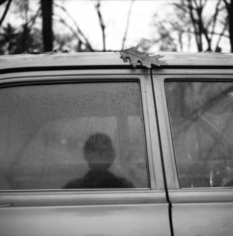 Vivian Maier- Self-Portrait (Car Window Reflection with Leaf)