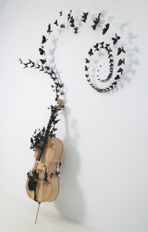 PAUL VILLINSKIFable [detail], 2010found cello and aluminum cans, soot, wire96 x 65 x 16 inches