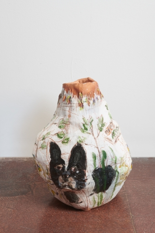 A small gourd-shaped ceramic vessel with painting of a small dog and wildflowers