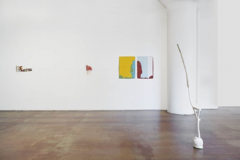 an installation image of kristine wood's exhibition. a white papier-mache sculpture is in the foreground at the gallery in front of two monoprints and two small weavings to the left.