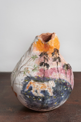 a gourd-shaped handbuilt ceramic vessel with a glaze painting of a mountain lion and palm trees