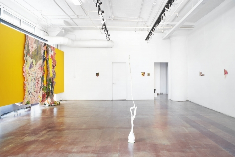 an installation shot of kristine woods' exhibition. a full view of the gallery