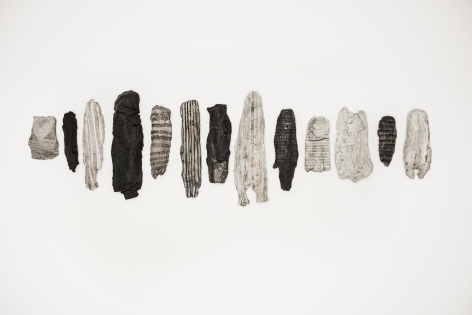 Erin Woodbrey  The Fragment Series, 2019  India ink on fired porcelain formed from fabric and wood  Variable Dimensions