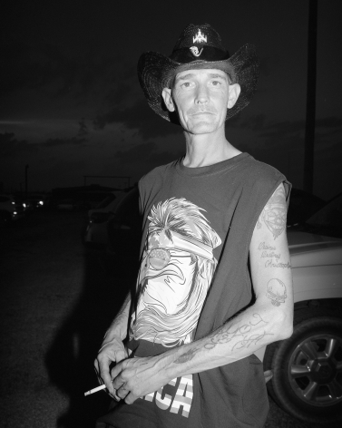 Patrice Aphrodite Helmar  Man in parking lot at Oklahoma Rodeo, 2017  C-print  76 x 61 cm / 30 x 24 in  Edition of 5 + 2 AP
