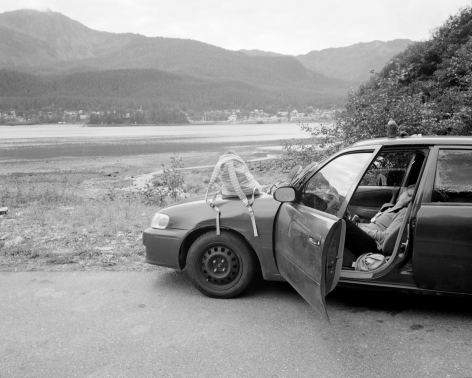 Patrice Aphrodite Helmar  Woman napping in her car - Thane Road, Alaska, 2017  C-print  41 x 51 cm / 16 x 20 in  Edition of 5 + 2 AP