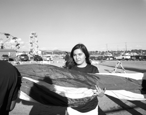Patrice Aphrodite Helmar  Girl holding flag at New Mexico Rodeo, 2016  C-print  41 x 51 cm / 16 x 20 in  Edition of 5 + 2 AP