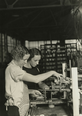 Lewis Hine - Two girls stamping glass jars in the art room at T. C. Wheaton Company. Millville, New Jersey, 1936-37 Gelatin silver print; printed c.1936-37 6 5/8 x 4 5/8 in.