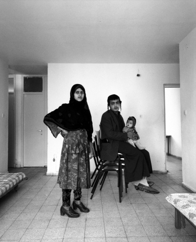 Frédéric Brenner: Exile at Home - Lewi and Nadra Faez and Their Newborn, Rehovot, Israel, 1993 - Howard Greenberg Gallery