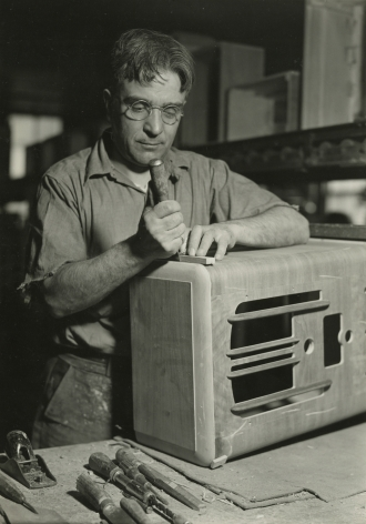 Lewis Hine, Cabinet repair man preparing to cut a piece of veneer. RCA Victor, Camden, New Jersey, March 4, 1937