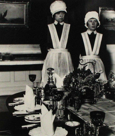 Bill Brandt - Parlourmaid and Underparlourmaid ready to serve dinner, 1936 - Howard Greenberg Gallery