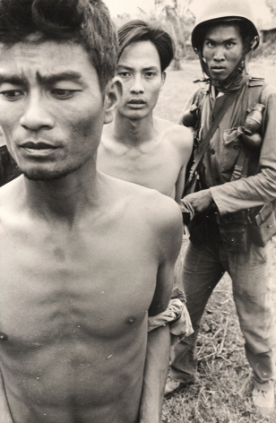 Don McCullin, Round up of Suspected Vietcong Prisoners, Mekong Delta, Vietnam, 1964, Howard Greenberg Gallery, 2019