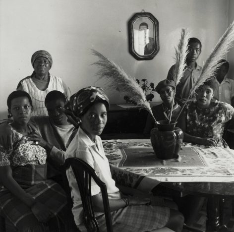 David Goldblatt - Untitled (group gathered around table), 1972 - Howard Greenberg Gallery