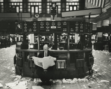 Marvin Newman - Broker Reading Newspaper in New York Stock Exchange After Closing, 1957 - Howard Greenberg Gallery