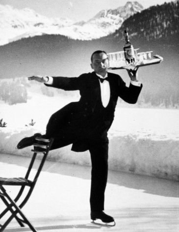 Alfred Eisenstaedt - Waiter on iceskates at the ice rink of the Grand Hotel, St. Moritz, 1932 - Howard Greenberg Gallery