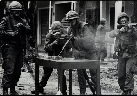 Don McCullin, Charlie Company Use Set Position in the Middle of the Road to Shoot at Distant Running N.V.A. Soldiers, Hue, Vietnam, 1968, Howard Greenberg Gallery, 2019