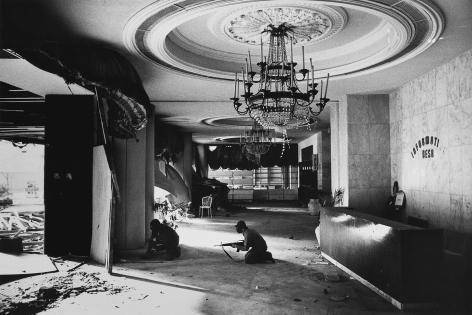 Don McCullin, Christian Gunmen in foyer of Holiday Inn, Beirut, 1976, Howard Greenberg Gallery, 2019