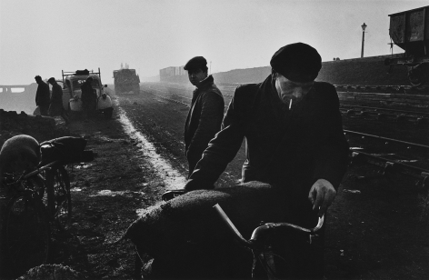 Don McCullin, Unemployed men gathering coal from the shore, West Hartlepool, County Durham, 1963, Howard Greenberg Gallery, 2019