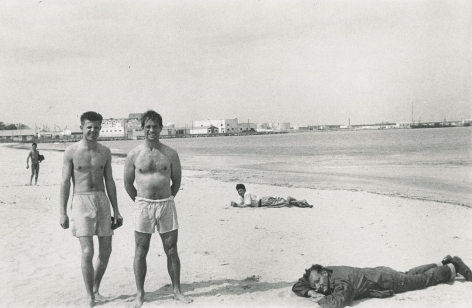 Allen Ginsberg - Peter Orlovsky and Jack Kerouac squinting in morning sunlight, William Burroughs prone observing in his olive green army jacket, Tangier, 1957 - Howard Greenberg Gallery