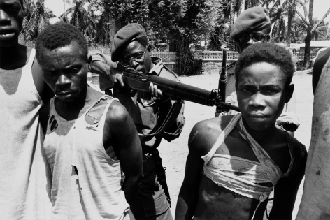 Don McCullin, Congolese Soldiers Tormenting Captured Lumumbist Freedom Fighters before Killing Them, 1964, Howard Greenberg Gallery, 2019