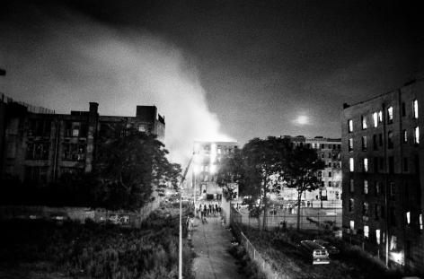 Ken Schles - Burning Building with Moonrise, 1984 - Howard Greenberg Gallery