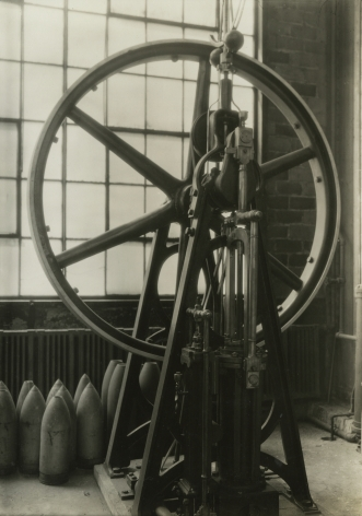 Lewis Hine, Stationary steam engine built by M.W. Baldwin before 1830, Baldwin Locomotive Works, Eddystone, Pennsylvania, May 1937   Gelatin silver print; printed c.1937   6 5/8 x 4 5/8 inches