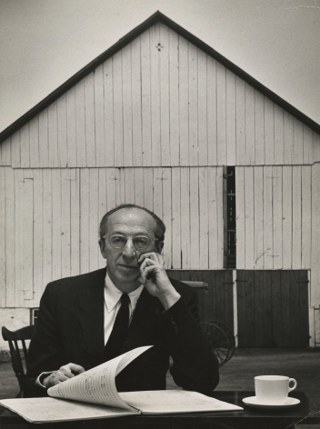 Gordon Parks - Composer Aaron Copland sitting at table with score in front of the barn, 1955 - Howard Greenberg Gallery