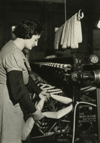 lewis hine, After drying, the skeins are taken from the rack and each skein is put on a swift of the winding machine, Paterson, New Jersey, March 18, 1937   Gelatin silver print; printed c.1937   6 5/8 x 4 5/8 inches
