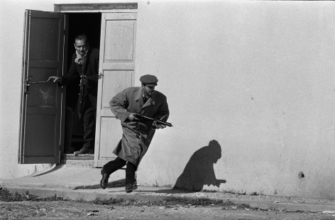 Don McCullin, Turkish defender leaving the side entrance of a cinema, Limassol, Cyprus, 1964, Howard Greenberg Gallery, 2019