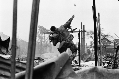 Don McCullin, US Marine Hurling a Grenade Seconds before Being Shot Through the Left Hand, Hue, Vietnam, 1968, Howard Greenberg Gallery, 2019