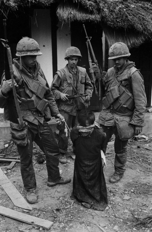 Don McCullin, US Soldiers Tormenting a Civilian in the Old City of Hue During the Tet Offensive, Hue, 1968, Howard Greenberg Gallery, 2019