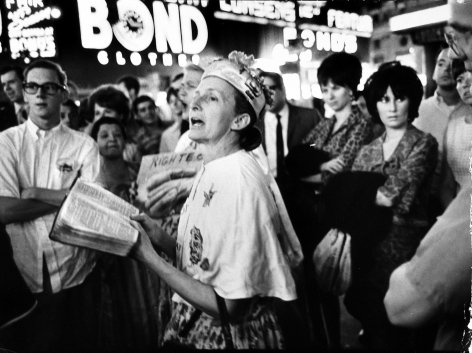 "Gary Winogrand - Street corner evangelist ""Rosie"" preaching at Broadway & 45th Street, New York City, 1966 - Howard Greenberg Gallery"