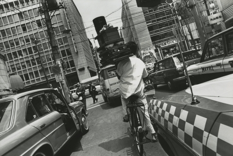 Eliot Elisofon - Untitled (delivery man riding bicycle on Japanese street), 1967 - Howard Greenberg Gallery