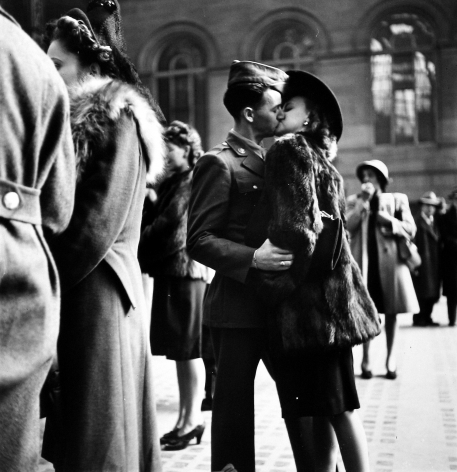 Alfred Eisenstaedt - Couple in Penn Station sharing farewell kiss before he ships off to war during WWII, NY, 1943 - Howard Greenberg Gallery