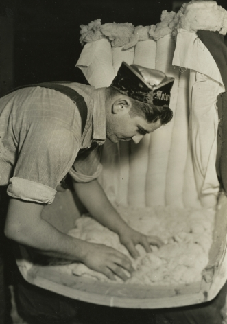 lewis hine, Applying filling to a channel back chair, Tomlinson Chair Manufacturing Co., High Point, North Carolina, 1937   Gelatin silver print; printed c.1937   6 5/8 x 4 5/8 inches