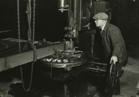 lewis hine, Machinist shaping a section of a driving-rod for largest locomotive, Baldwin Locomotive Works, Eddystone, Pennsylvania, March 1937   Gelatin silver print; printed c.1937   4 5/8 x 6 5/8 inches