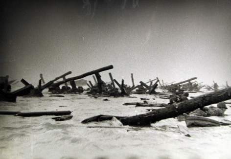 Robert Capa - American soldiers landing on Omaha Beach, D-Day, Normandy, France, 6-Jun-44 - Howard Greenberg Gallery