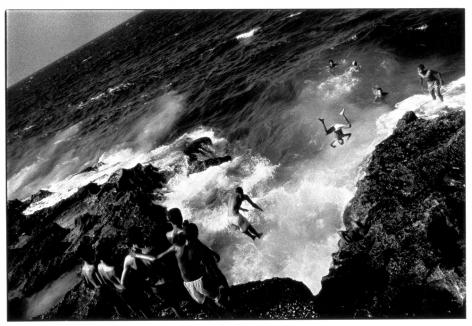 Ernesto Bazan, Cuba, Sous Les Etoiles Gallery, Bazan, Malecon, Havana, children jumping, beach, Special Period