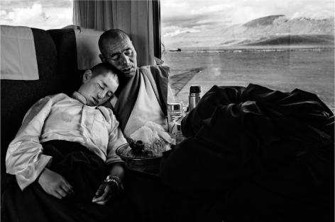 Laurent Zylberman, A Journey in Tibet, Monks resting in the T-27 train, 2008, Sous Les Etoiles Gallery