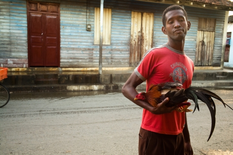 Magdalena Solé, Cuba - Hasta Siempre (Cuba Forever), Boy with Fighting Rooster, Baracoa, 2013, Sous Les Etoiles Gallery
