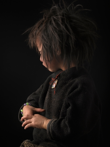 David Zimmerman, One Voice, Portrait of young girl Tenzin Kalzom with unkempt hair and chapped hands, 2012, Sous Les Etoiles Gallery