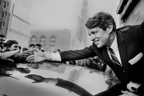 Jean-Pierre Laffont, Bob Kennedy reaching hand over car, Turbulent America, Sous Les Etoiles Gallery