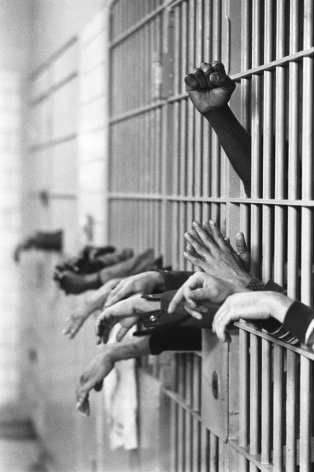 Jean-Pierre Laffont, Tomb Prison Hands from behind the bars, Turbulent America, Sous Les Etoiles Gallery