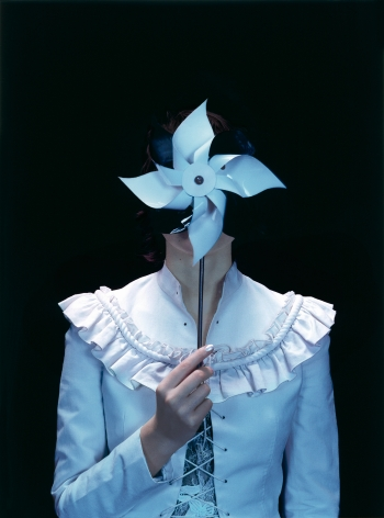 Sophie Delaporte, Early Fashion Work, Model holding handheld paper windmill before face, Sous Les Etoiles Gallery