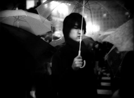 James Whitlow Delano, Mangaland, Under umbrella in nightime rain, Hachiko Shibuya, Tokyo, Japan, 2002, Sous Les Etoiles Gallery