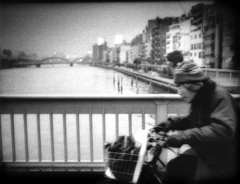 James Whitlow Delano, Mangaland, Cycling accross Sumida River Bridge in Ueno, Tokyo, Japan, 2005, Sous Les Etoiles Gallery